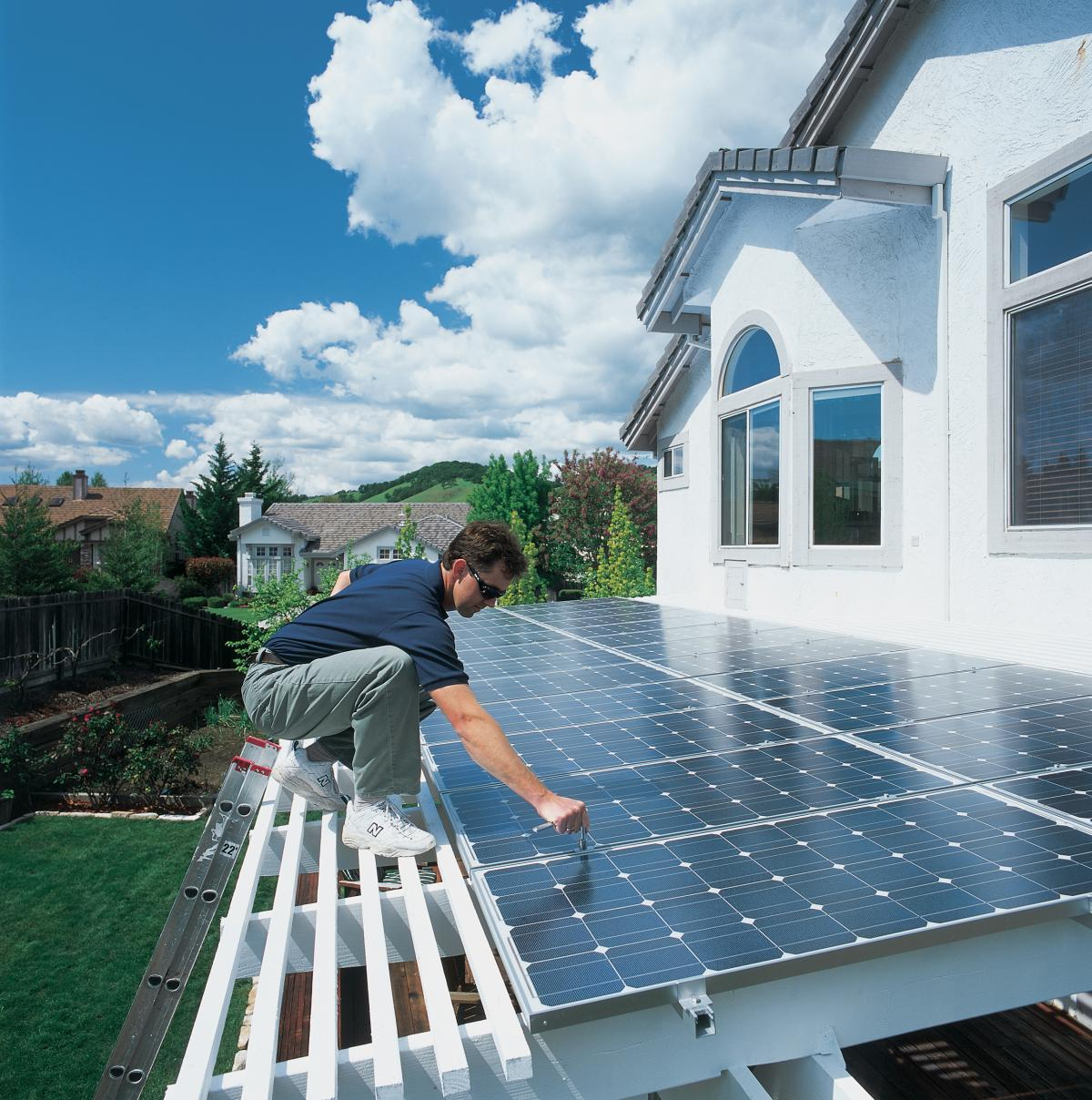 Residential solar installation man on roof