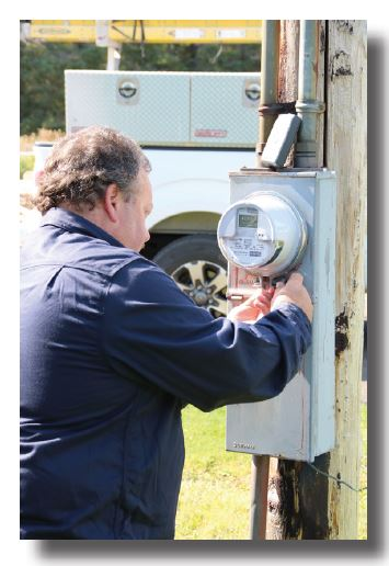 Technician removes an electrical meter